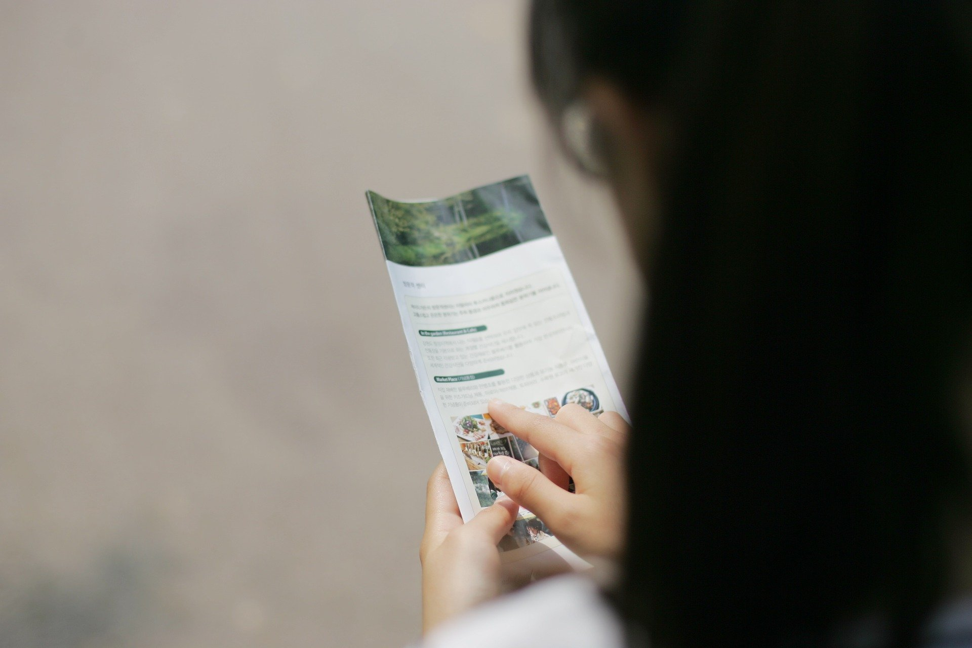 woman looking through a brochure