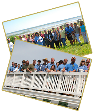 Staff and board on a bridge and in front of a river