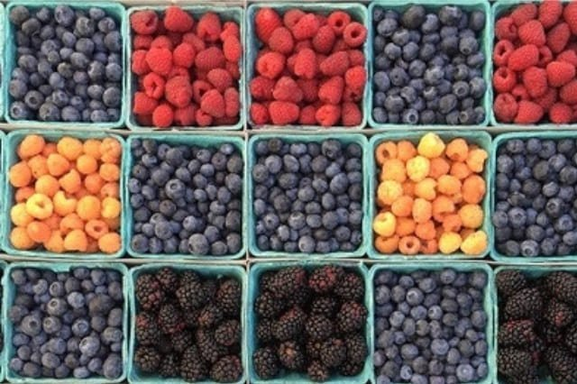 Various berries at a Farmer's Market.